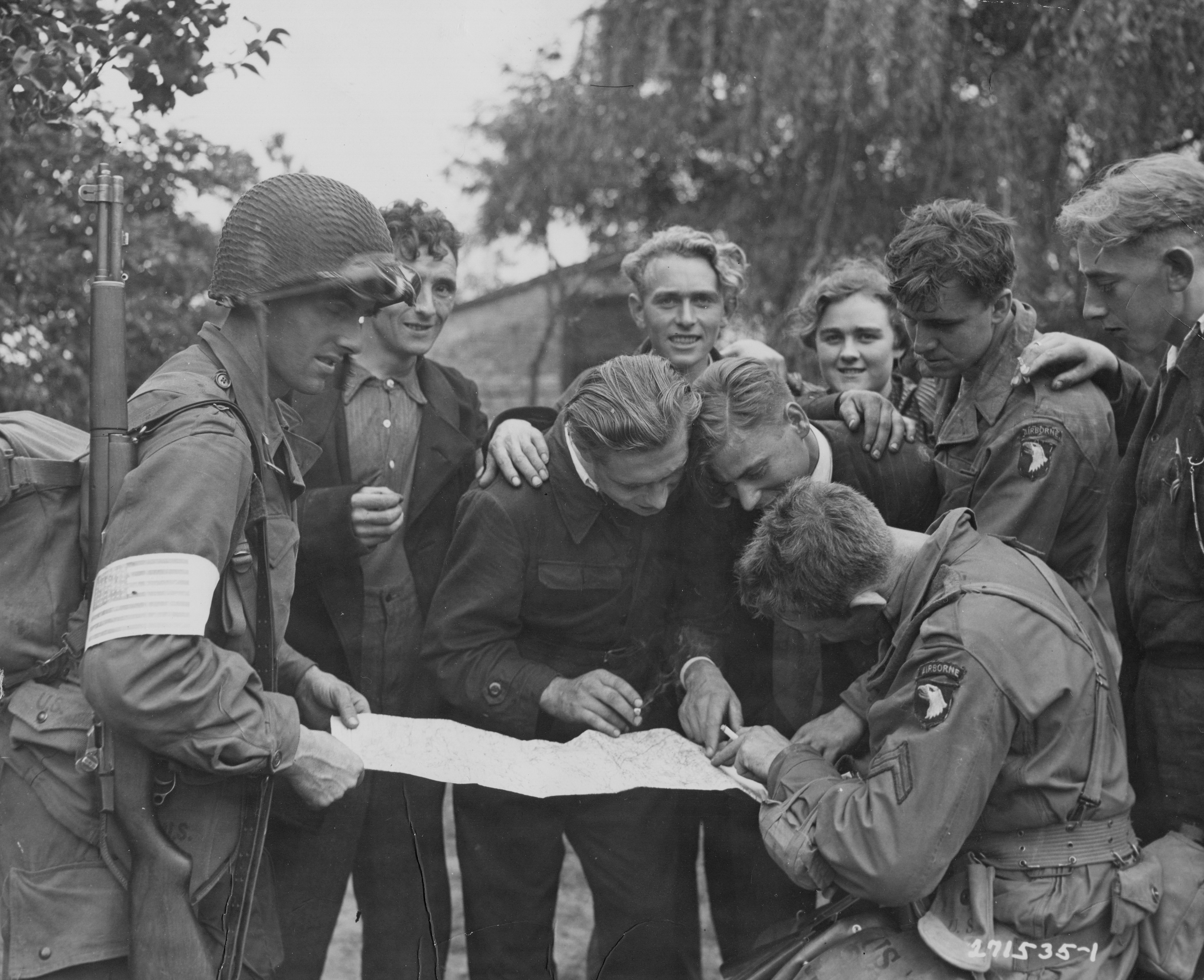 Dutch civilians with 101st Airborne Division Paratroopers during Operation Market Garden